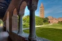 "A masterpiece of Romanesque art, Pomposa Abbey can be seen from a distance with its towering campanile, which dominates the surrounding countryside like a ""lighthouse"" in the sea of green that surrounds it."